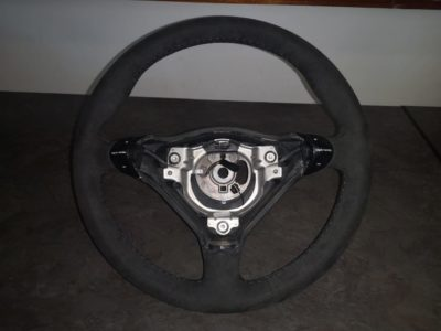 Reupholstered steering wheel in black alcantara and hand stitched with black cotton